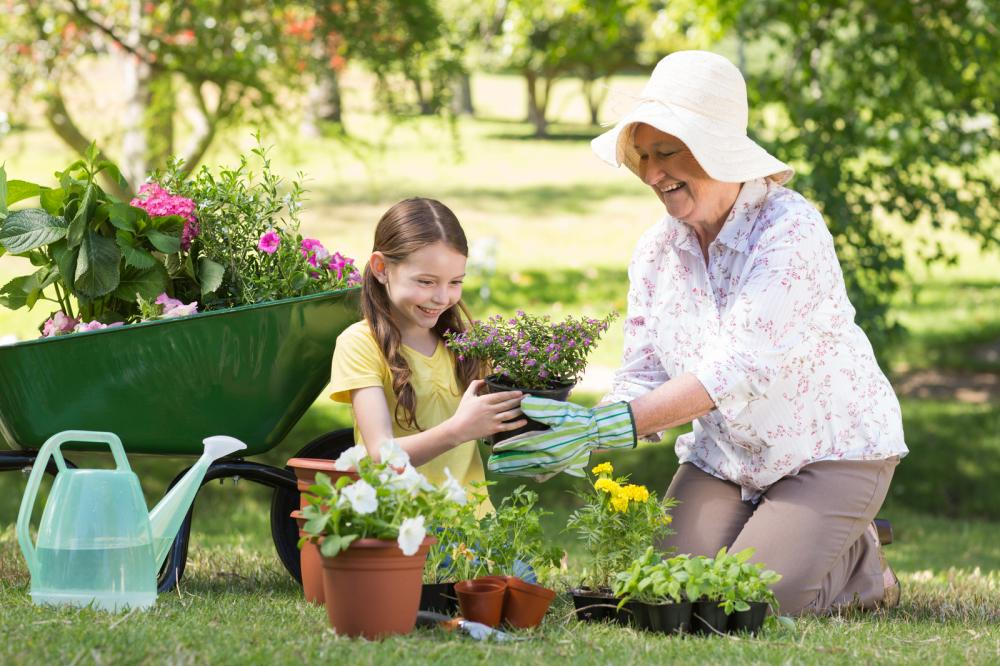happy-grandmother-with-her-granddaughter-gardening