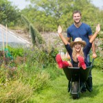 man-pushing-his-girlfriend-in-a-wheelbarrow