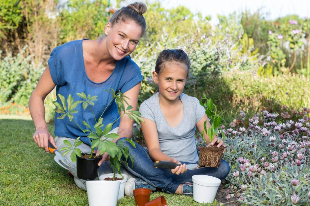 mother-and-daughter-tending-to-flowers