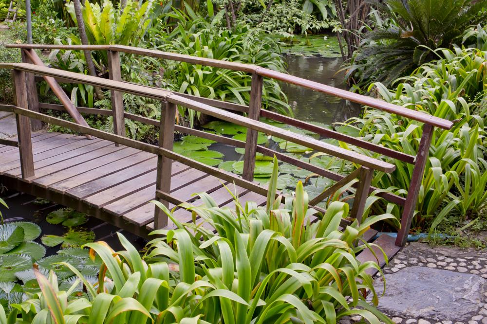 wooden-bridge-in-a-beautiful-garden
